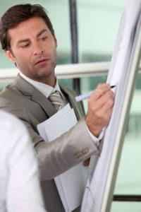 Male executive writing